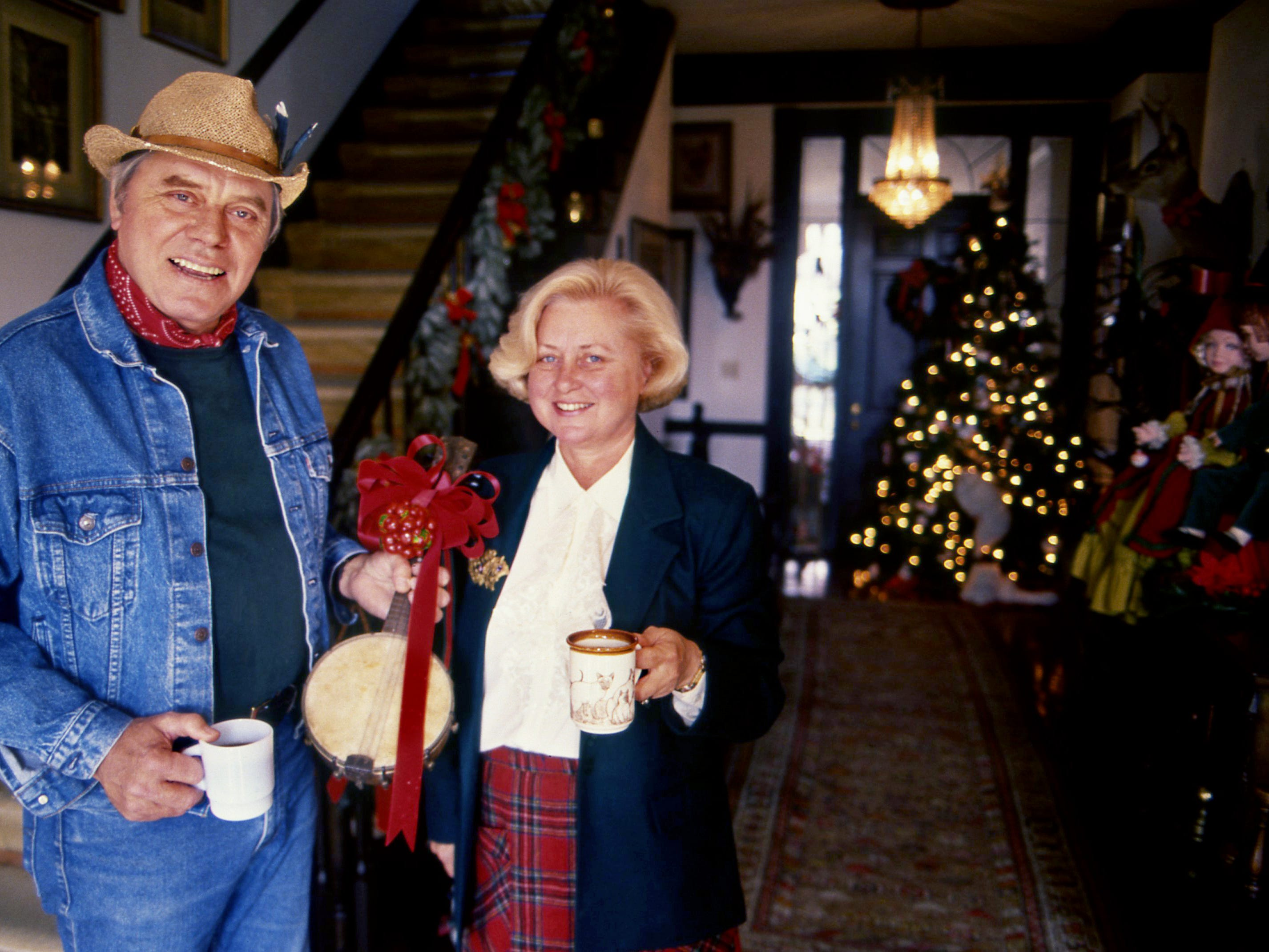 Tom T. Hall and wife Dixie stand ready on Nov. 21, 1988, with a welcoming cup of coffee for guests invited to their upcoming annual Christmas at Fox Hollow to benefit Animaland.
