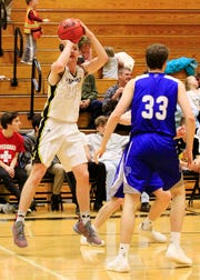 Fairview High's #24 Bill Eads helps the Jackets over take the Page Patriots with his incredible 3-pointers.