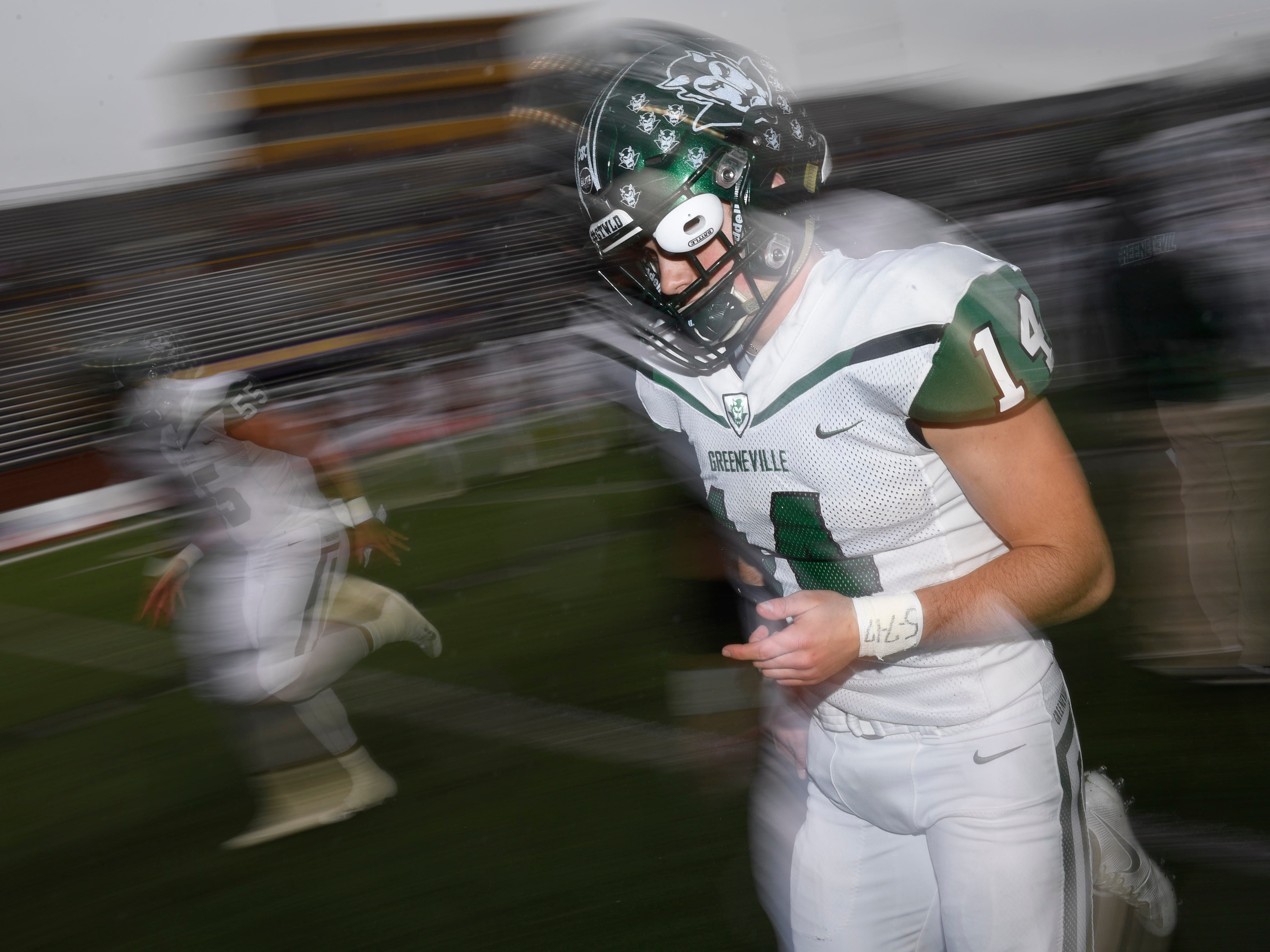 Greeneville's Dalton McLain (14) takes the field for the Class 4A BlueCross Bowl state championship at Tennessee Tech's Tucker Stadium in Cookeville, Tenn., on Thursday, Nov. 29, 2018.