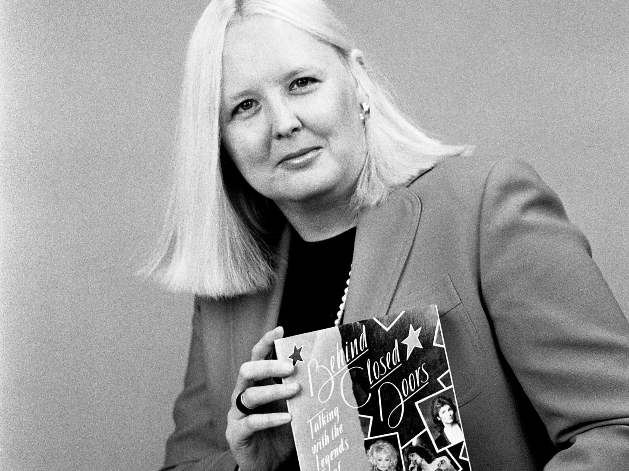 "Stereo Review journalist Alanna Nash shows off her new book, ""Behind Closed Doors: Talking with the Legends of Country Music,"" during an interview at The Tennessean on Nov. 21, 1988."