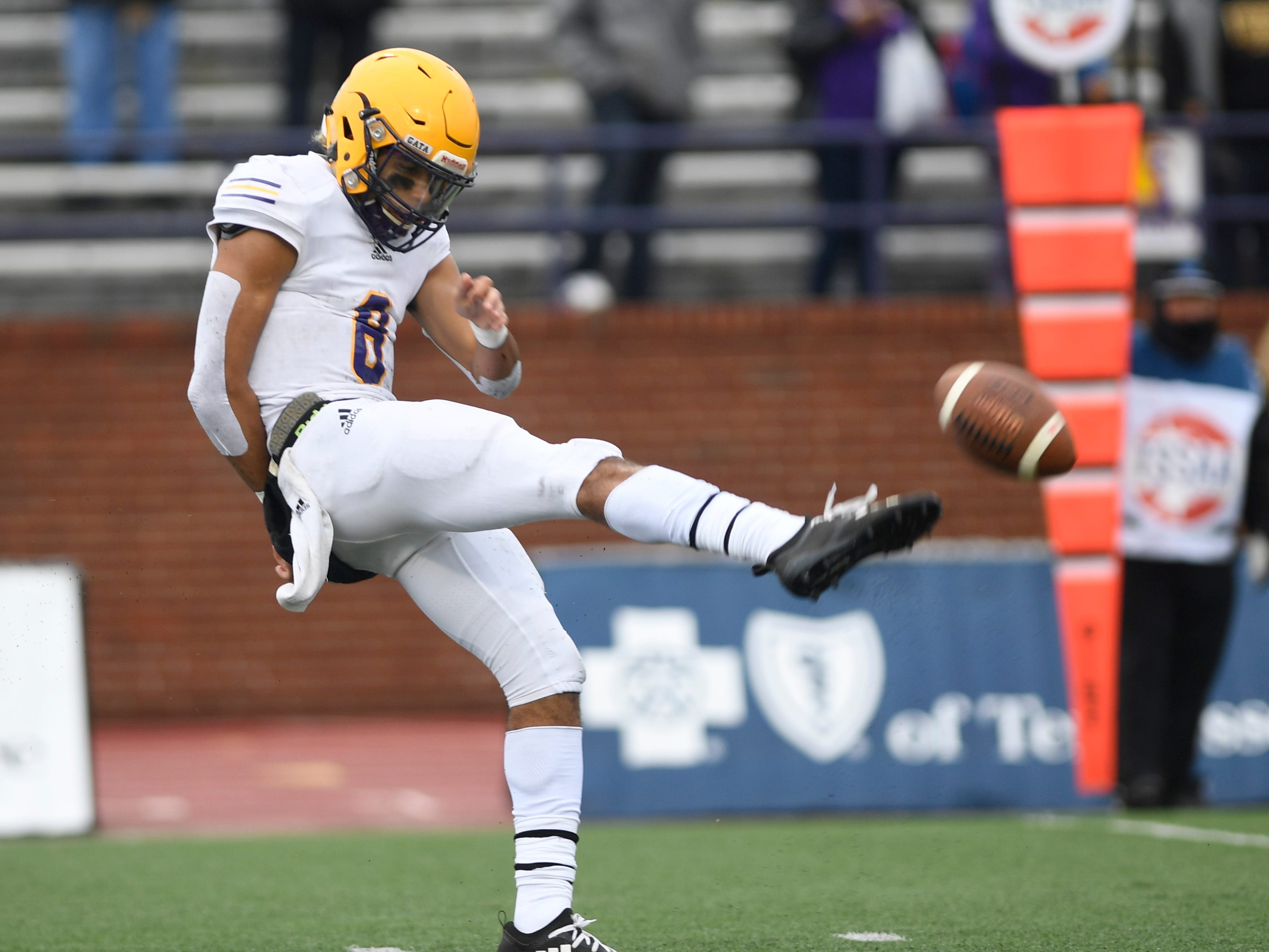 Trousdale County punter Keyvont Baines gets off a kick during the Class 2A BlueCross Bowl state championship at Tennessee Tech's Tucker Stadium in Cookeville, Tenn., on Thursday, Nov. 29, 2018.