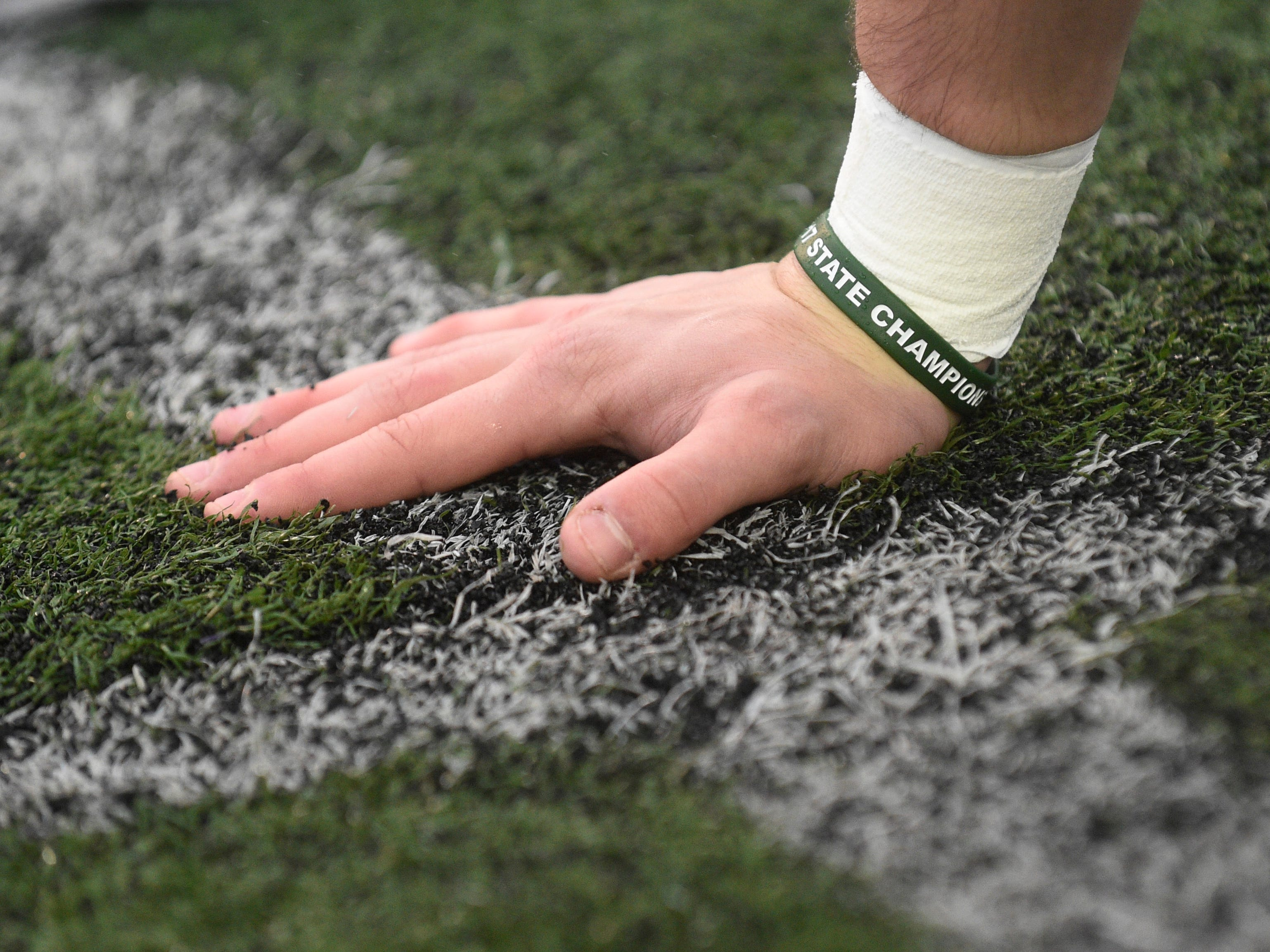 A Greeneville player wears a championship bracelet from 2017 before the Class 4A BlueCross Bowl state championship at Tennessee Tech's Tucker Stadium in Cookeville, Tenn., on Thursday, Nov. 29, 2018.