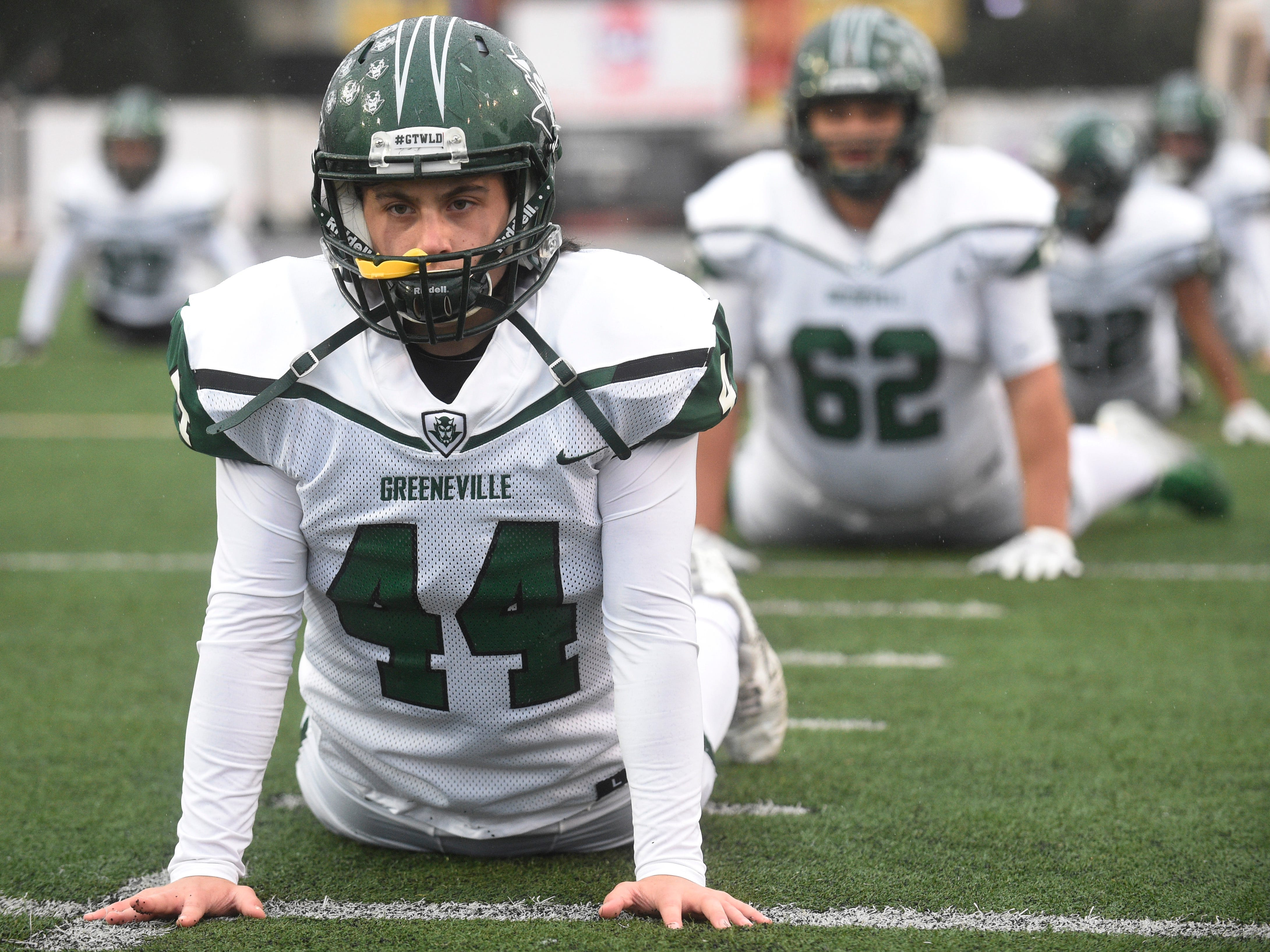 Greeneville's Ashton Greenier (44) and teammates stretch before the Class 4A BlueCross Bowl state championship at Tennessee Tech's Tucker Stadium in Cookeville, Tenn., on Thursday, Nov. 29, 2018.