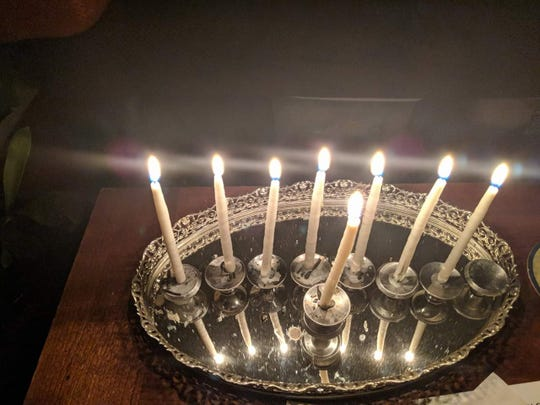 Miriam Leibowitz, who has a fine arts background, created her own menorah out door knobs and a mirrored vanity tray she picked up from a flea market in Nashville.