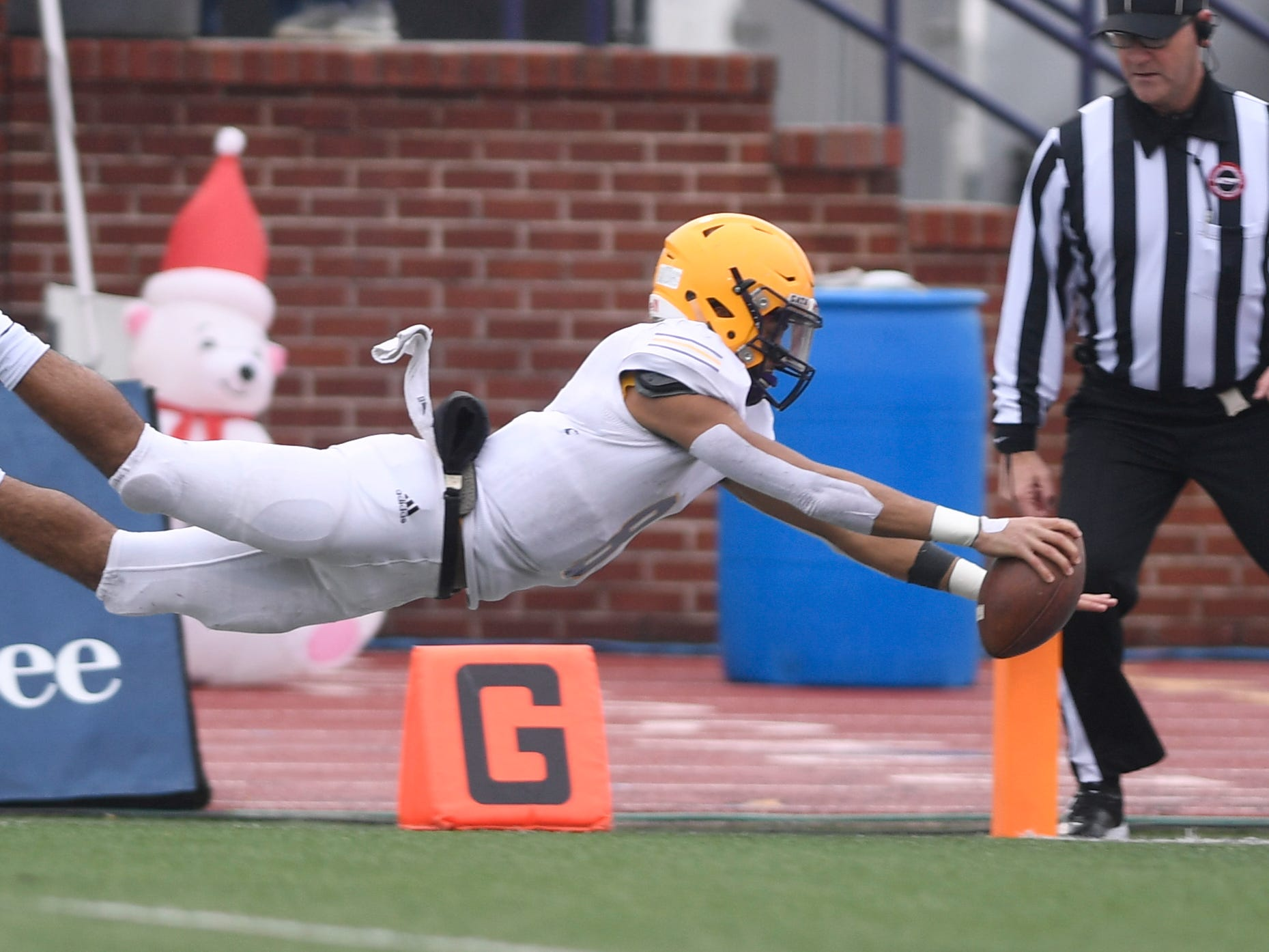 Trousdale's Keyvont Baines (8) scores in the second quarter of the Class 2A BlueCross Bowl state championship at Tennessee Tech's Tucker Stadium in Cookeville, Tenn., on Thursday, Nov. 29, 2018.