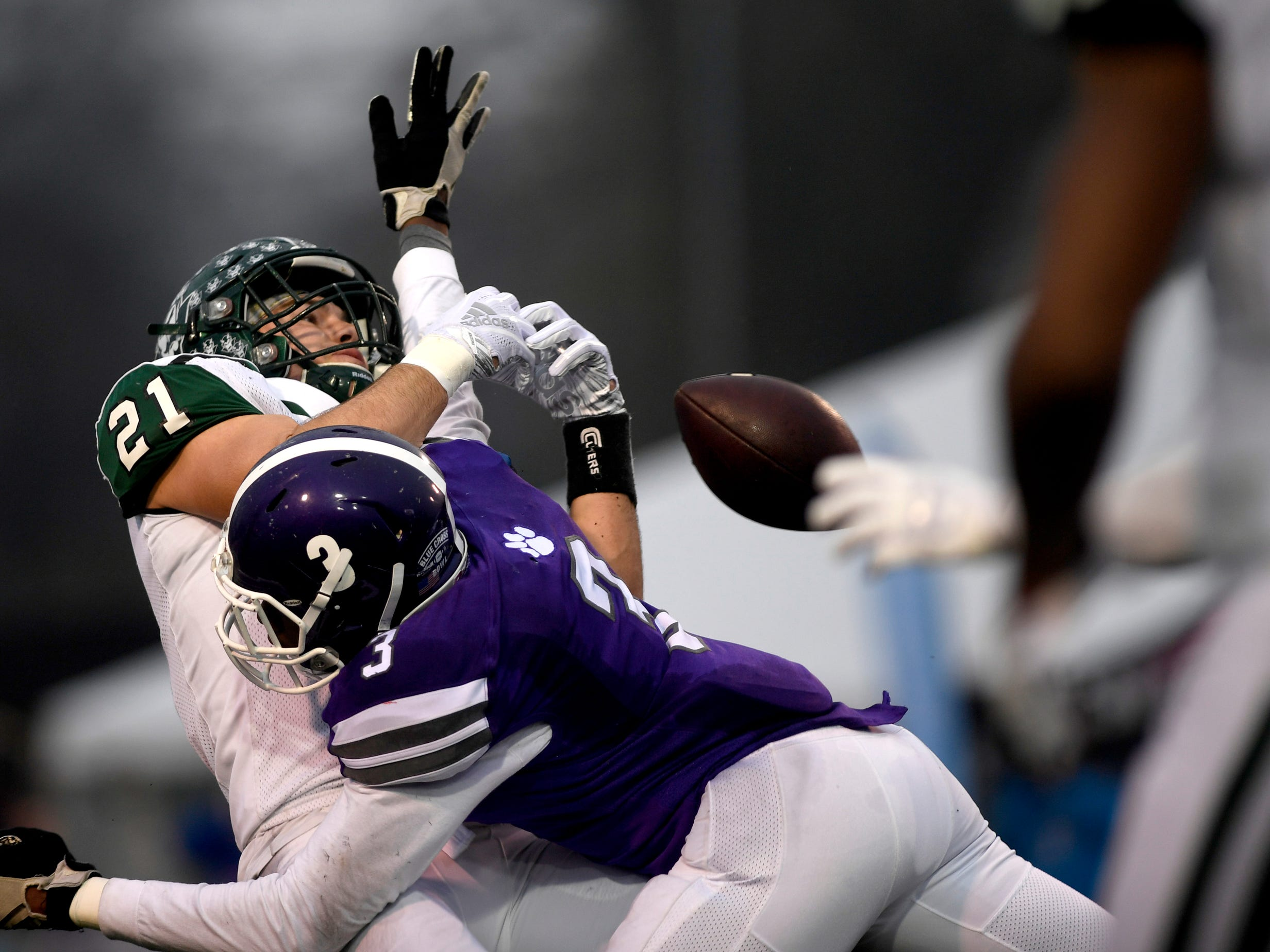Greeneville's Cameron Hite (21) misses a pass as Haywood's Marquis Pugh (3) covers Hite during the Class 4A BlueCross Bowl state championship Thursday, Nov. 29, 2018, at Tennessee Tech's Tucker Stadium in Cookeville, Tenn.