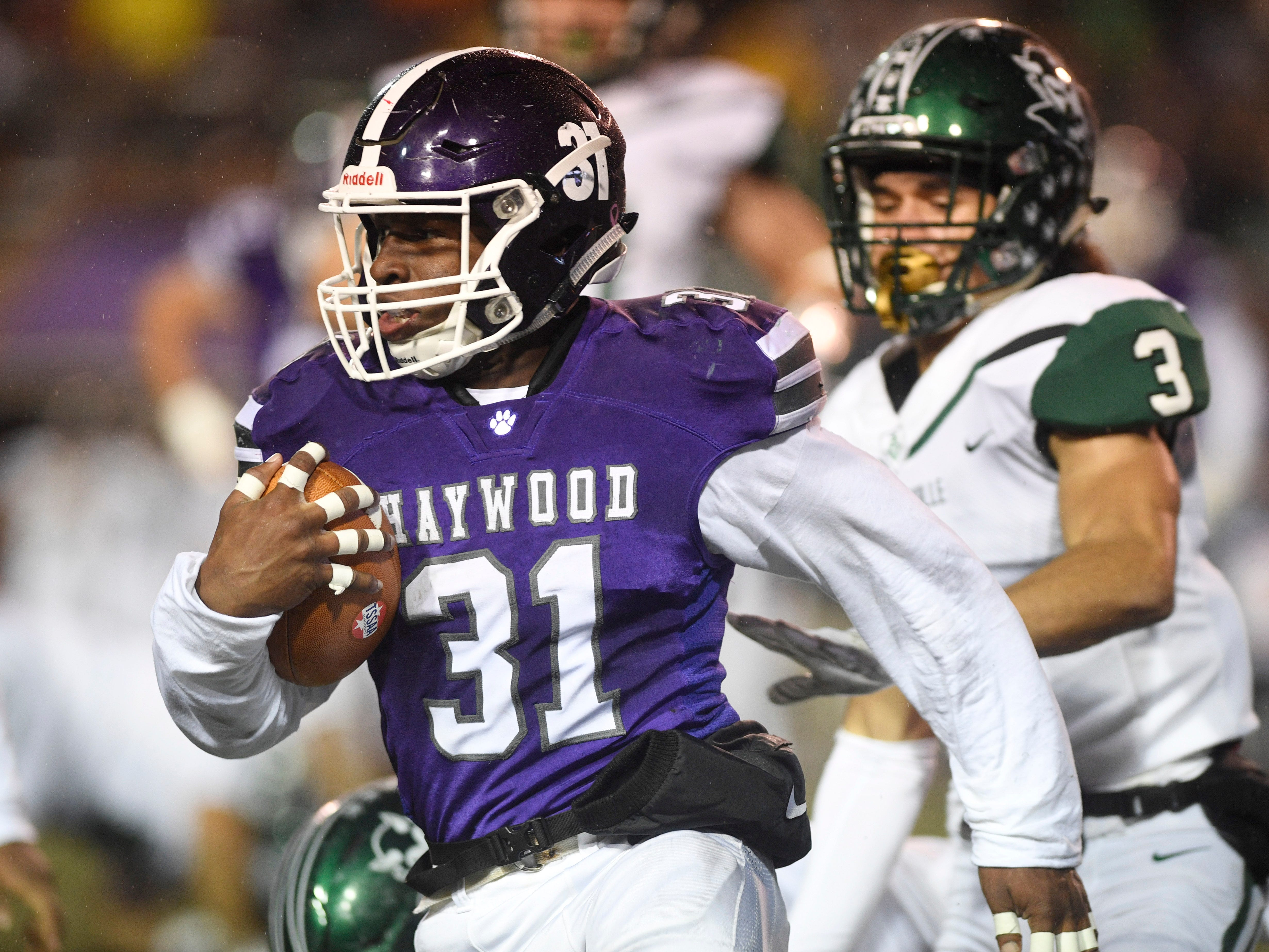 Haywood's  Decourtney Reed (31) gains yards in the second half during the Class 4A BlueCross Bowl state championship at Tennessee Tech's Tucker Stadium in Cookeville, Tenn., on Thursday, Nov. 29, 2018.