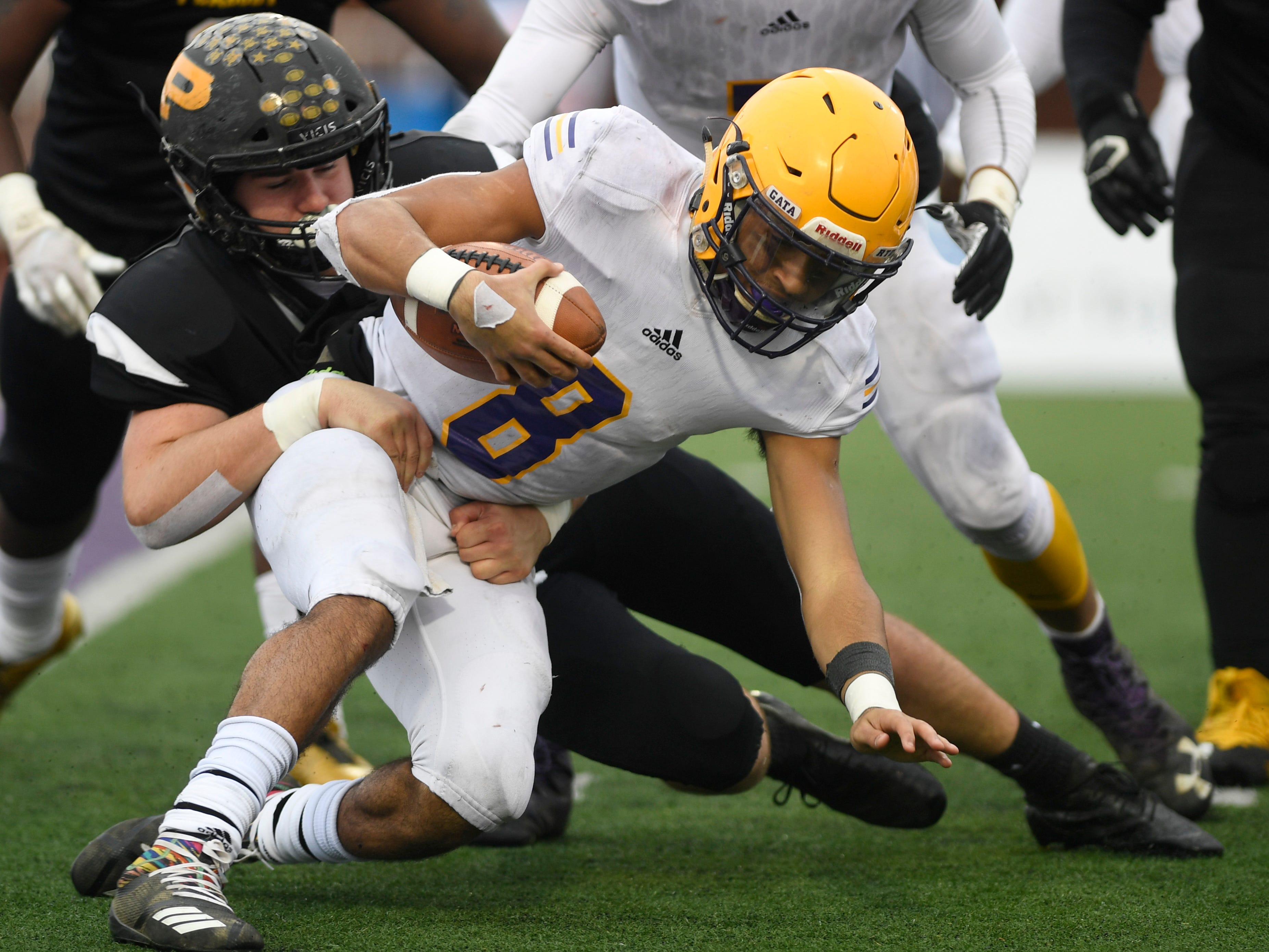 Trousdale's Keyvont Baines (8) is brought down by a Peabody defender in the third quarter during the Class 2A BlueCross Bowl state championship at Tennessee Tech's Tucker Stadium in Cookeville, Tenn., on Thursday, Nov. 29, 2018.