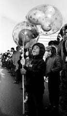 Kevin Rankin, 5, son of Mr. and Mrs. Billie Rankin, watches the wind whip his balloons during the 16th annual Nashville Christmas parade Dec. 8, 1968.