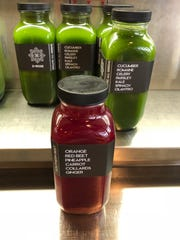 The grab-and-go case at E + Rose has a wide assortment of cold-pressed wellness juices like the Southern Beet and Organic All Greens.