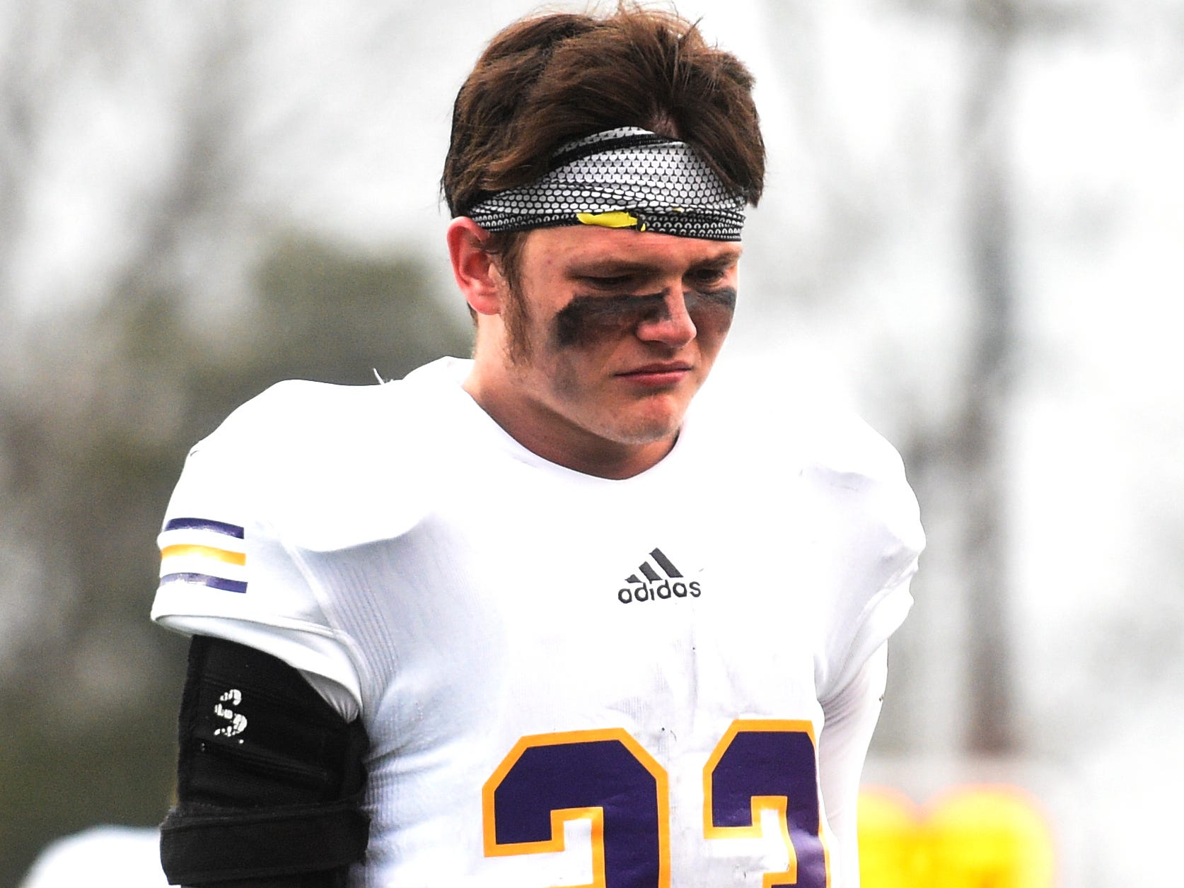 Trousdale's Houston Stafford (23) walks off the field after the team's 17-9 loss to Peabody in the Class 2A BlueCross Bowl state championship at Tennessee Tech's Tucker Stadium in Cookeville, Tenn., on Thursday, Nov. 29, 2018.