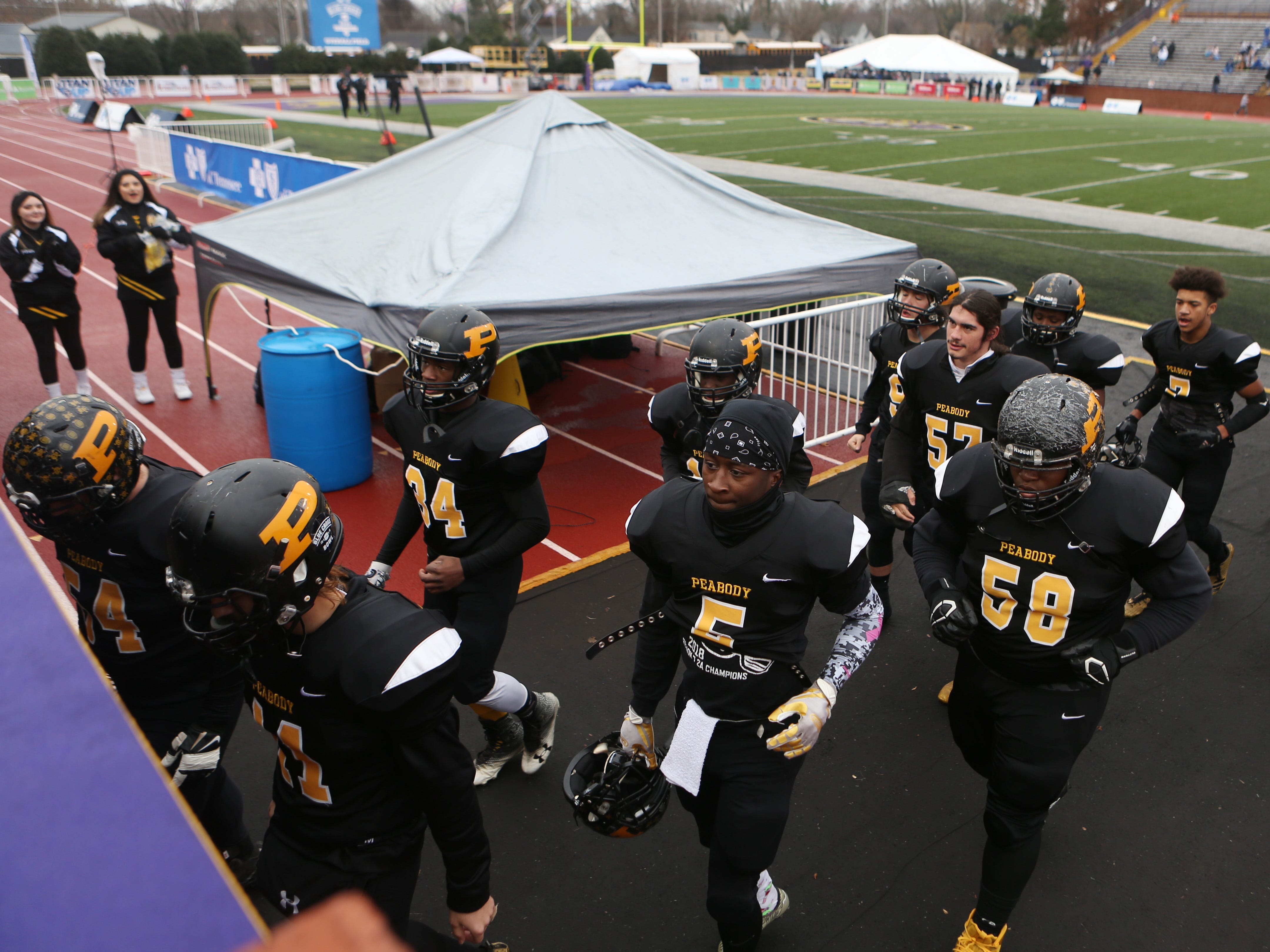 Peabody heads off the field before the Class 2A BlueCross Bowl state championship at Tennessee Tech's Tucker Stadium in Cookeville, Tenn., on Thursday, Nov. 29, 2018.