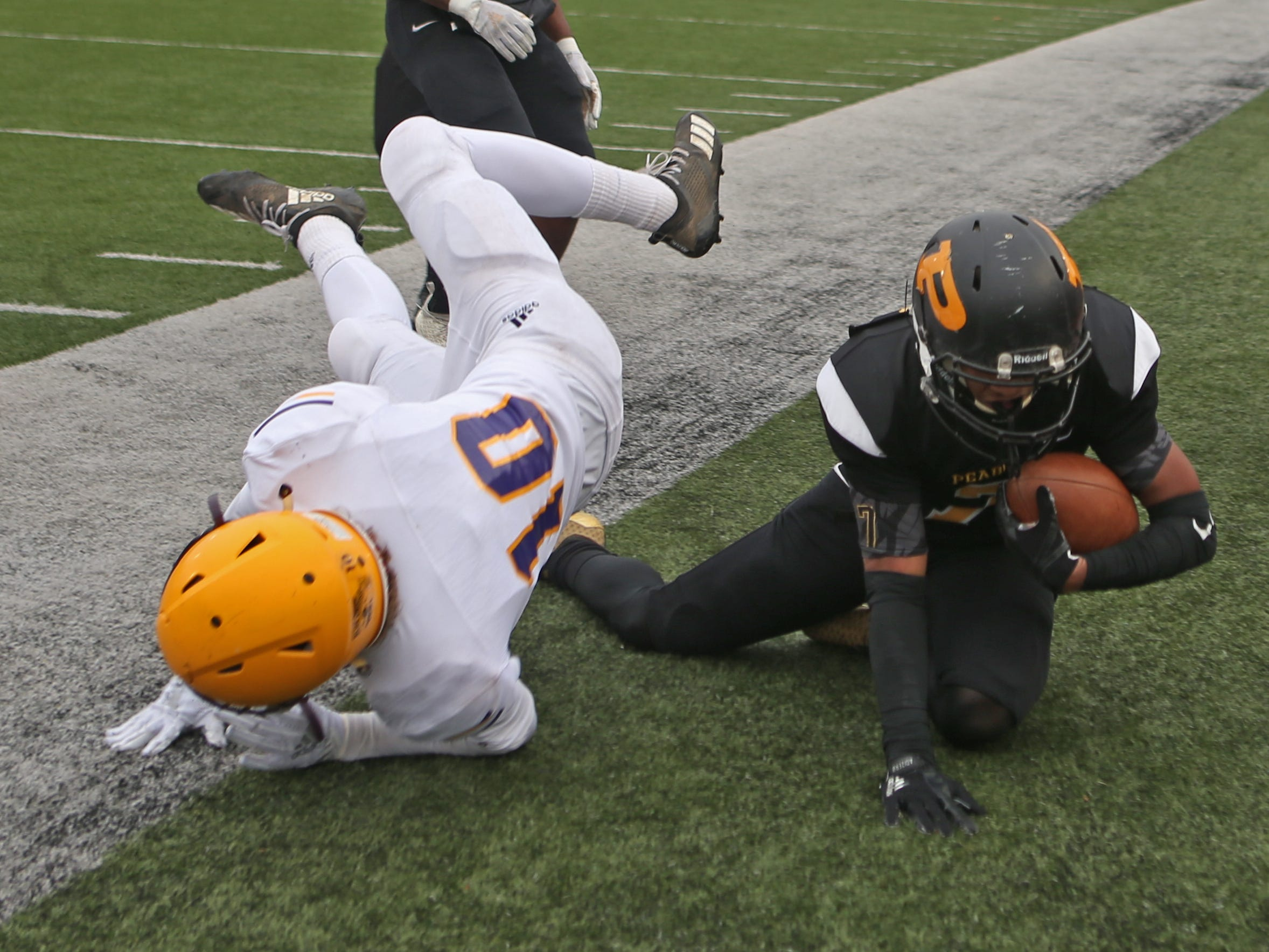 Trousdale's Alex Ford (10) and Peabody's Noah Halbrook (7) land out of bounds on a second-quarter run during the Class 2A BlueCross Bowl state championship at Tennessee Tech's Tucker Stadium in Cookeville, Tenn., on Thursday, Nov. 29, 2018.