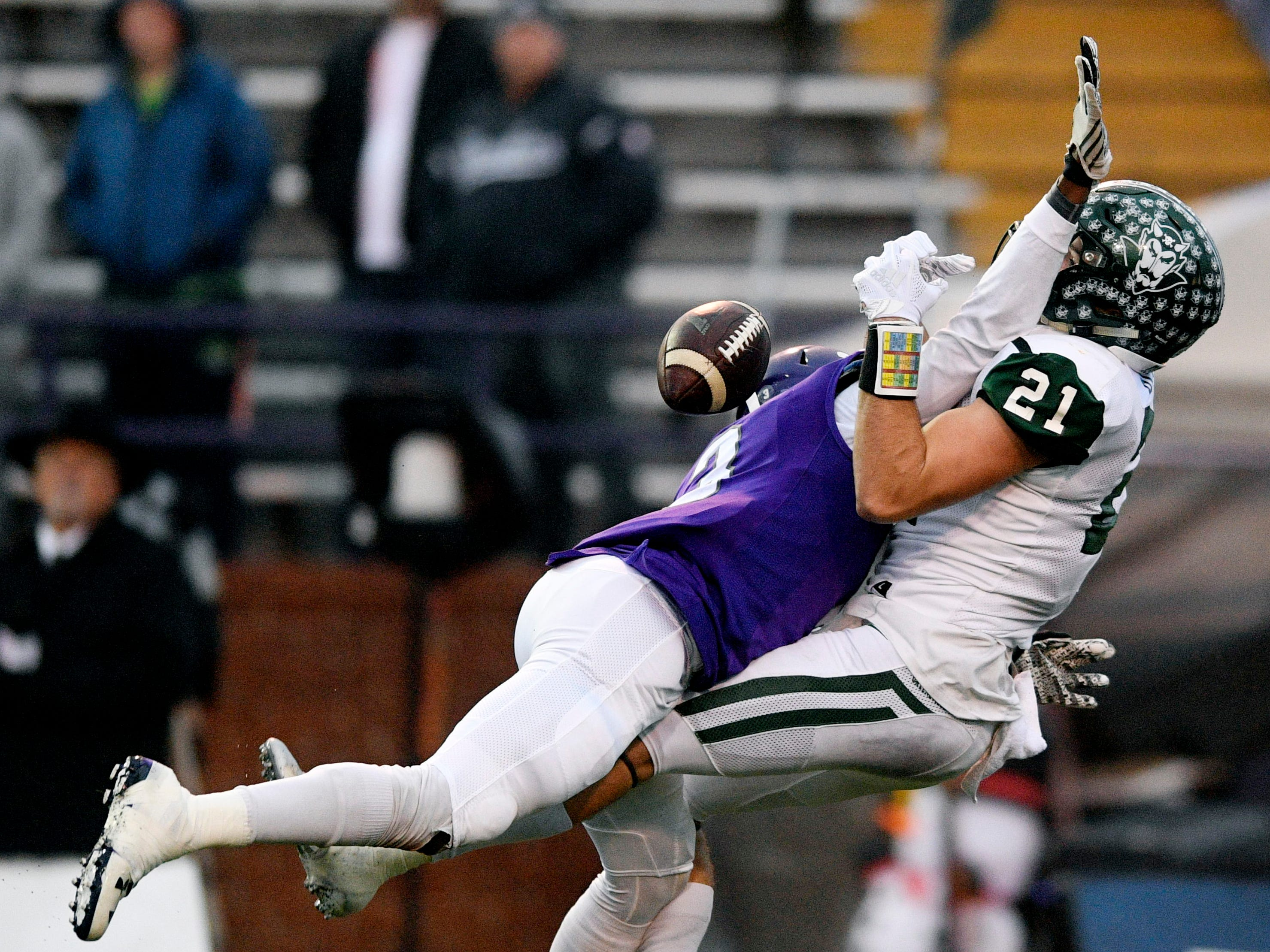 Haywood's  Marquis Pugh (3) breaks up a pass intended for Greeneville's Cameron Hite (21) in the first half during the Class 4A BlueCross Bowl state championship at Tennessee Tech's Tucker Stadium in Cookeville, Tenn., on Thursday, Nov. 29, 2018.