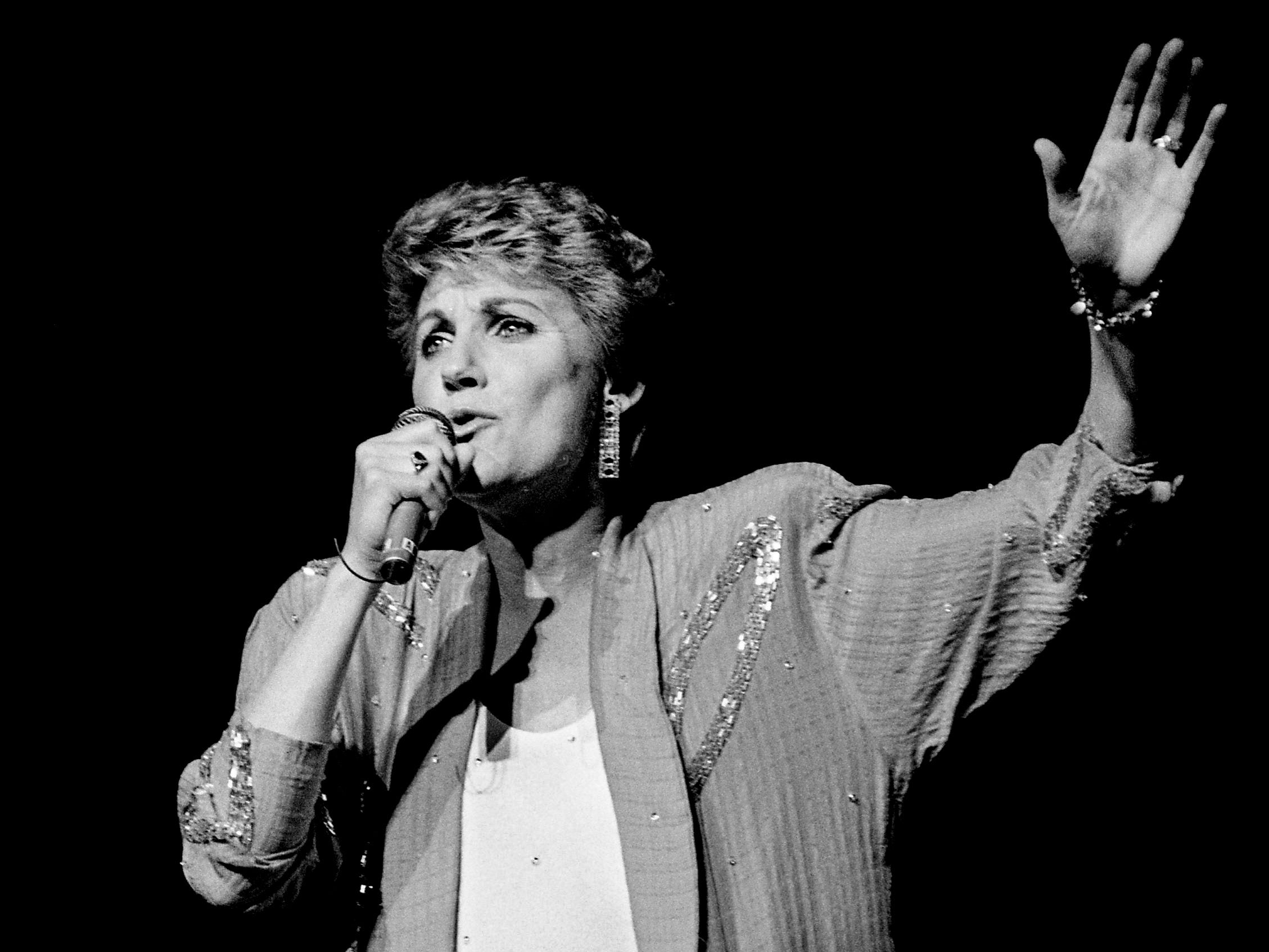 Anne Murray sings one of her many hits during a concert at the Grand Ole Opry House on Nov. 16, 1988, to benefit the Nashville Songwriters Association.