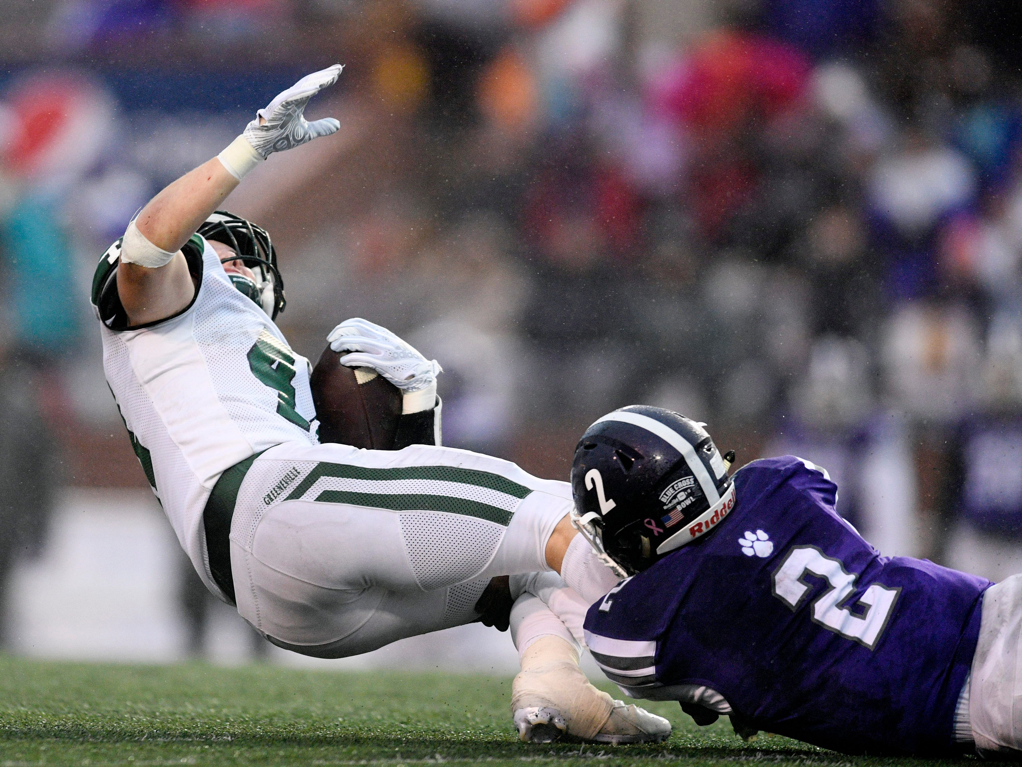 Greeneville's Blayne Ferguson (4) is stopped in the first half by Haywood's Deyondrius Hines (2) in the first half of the Class 4A BlueCross Bowl state championship at Tennessee Tech's Tucker Stadium in Cookeville, Tenn., on Thursday, Nov. 29, 2018.