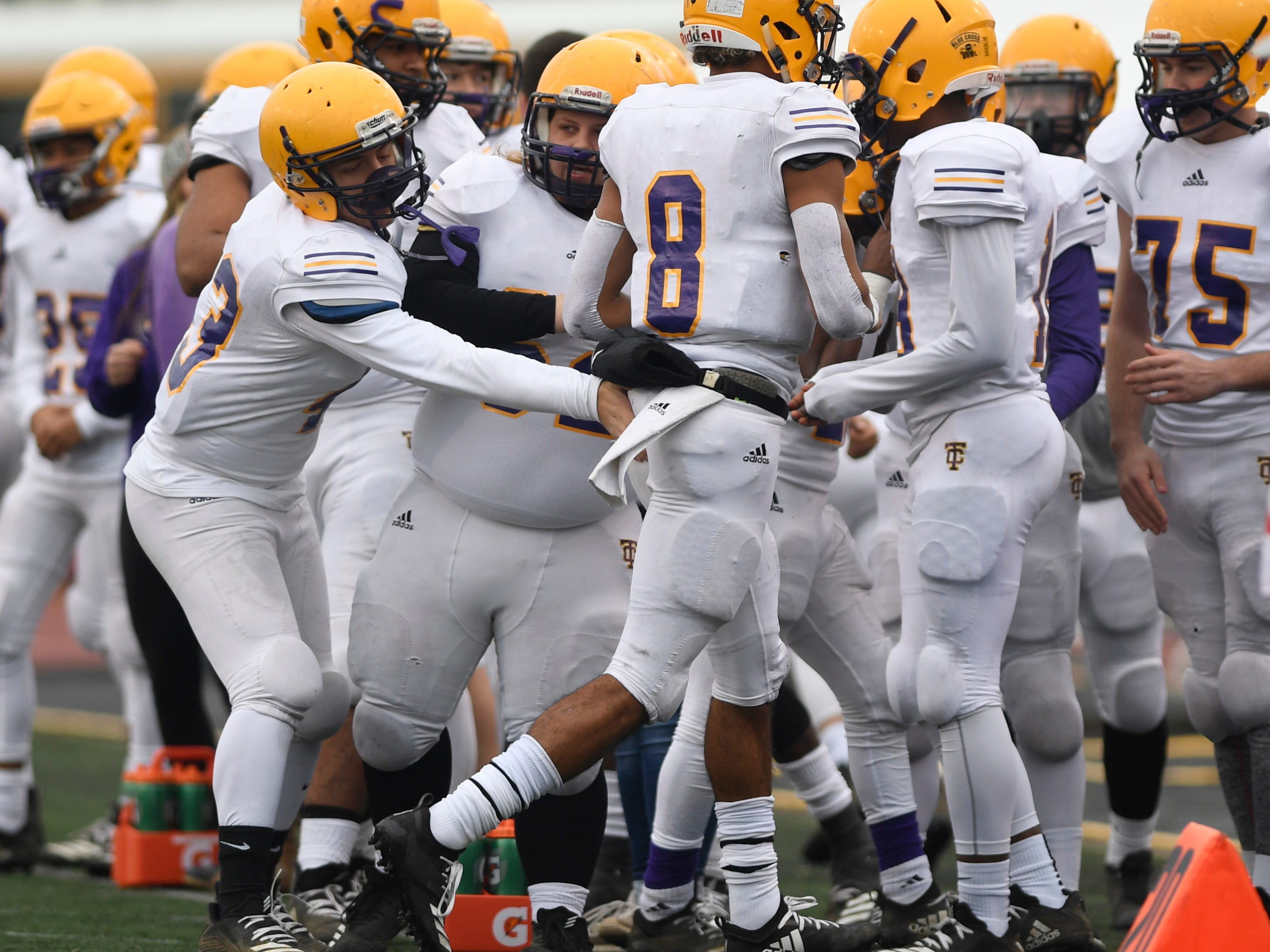 Trousdale's Keyvont Baines (8) is congratulated after his second quarter touchdown during the Class 2A BlueCross Bowl state championship at Tennessee Tech's Tucker Stadium in Cookeville, Tenn., on Thursday, Nov. 29, 2018.