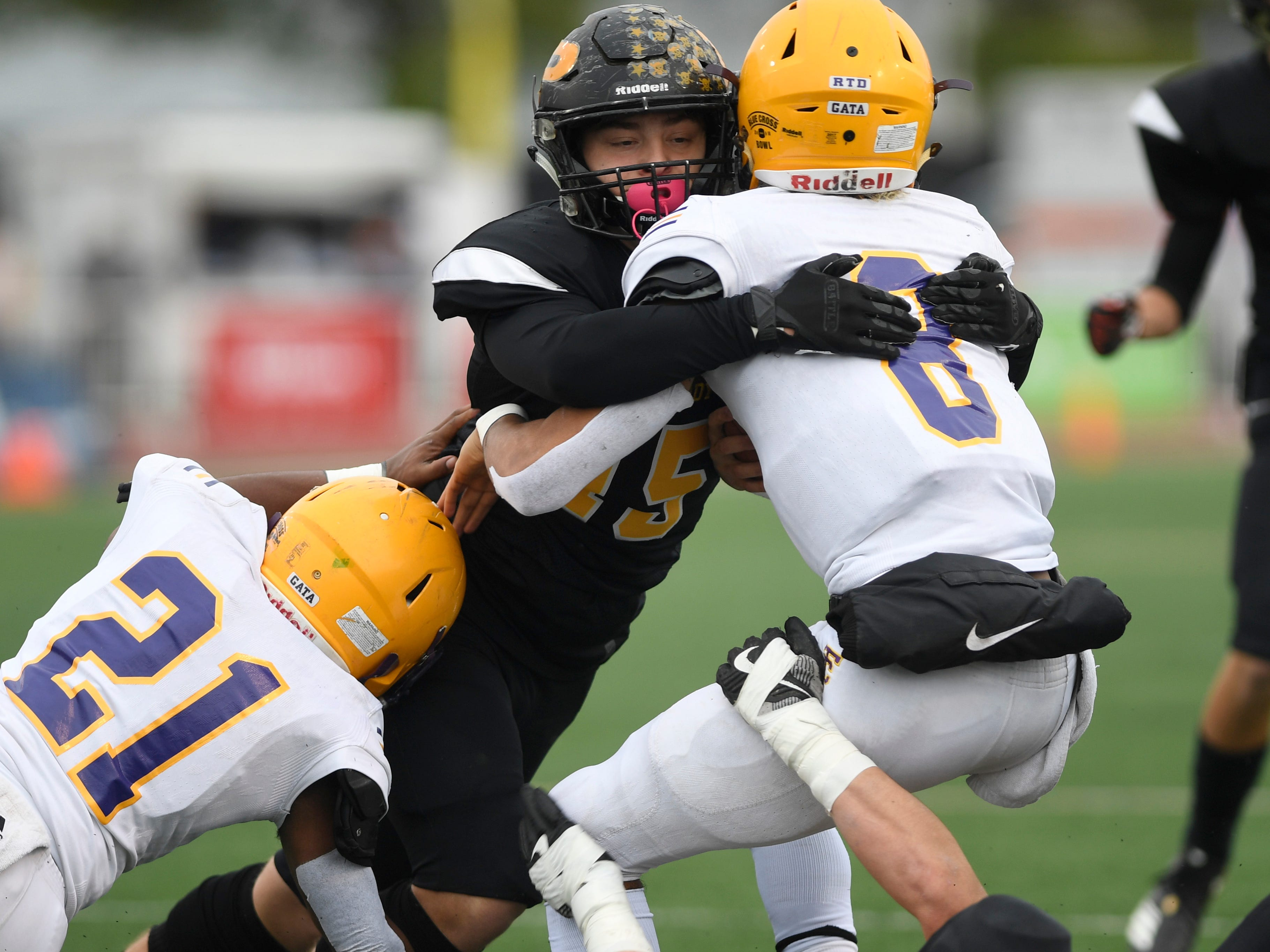 Peabody linebacker Jaime Hernandez stuffs Trousdale County quarterback Keyvont Baines in the first quarter during the Class 2A BlueCross Bowl state championship at Tennessee Tech's Tucker Stadium in Cookeville, Tenn., on Thursday, Nov. 29, 2018.