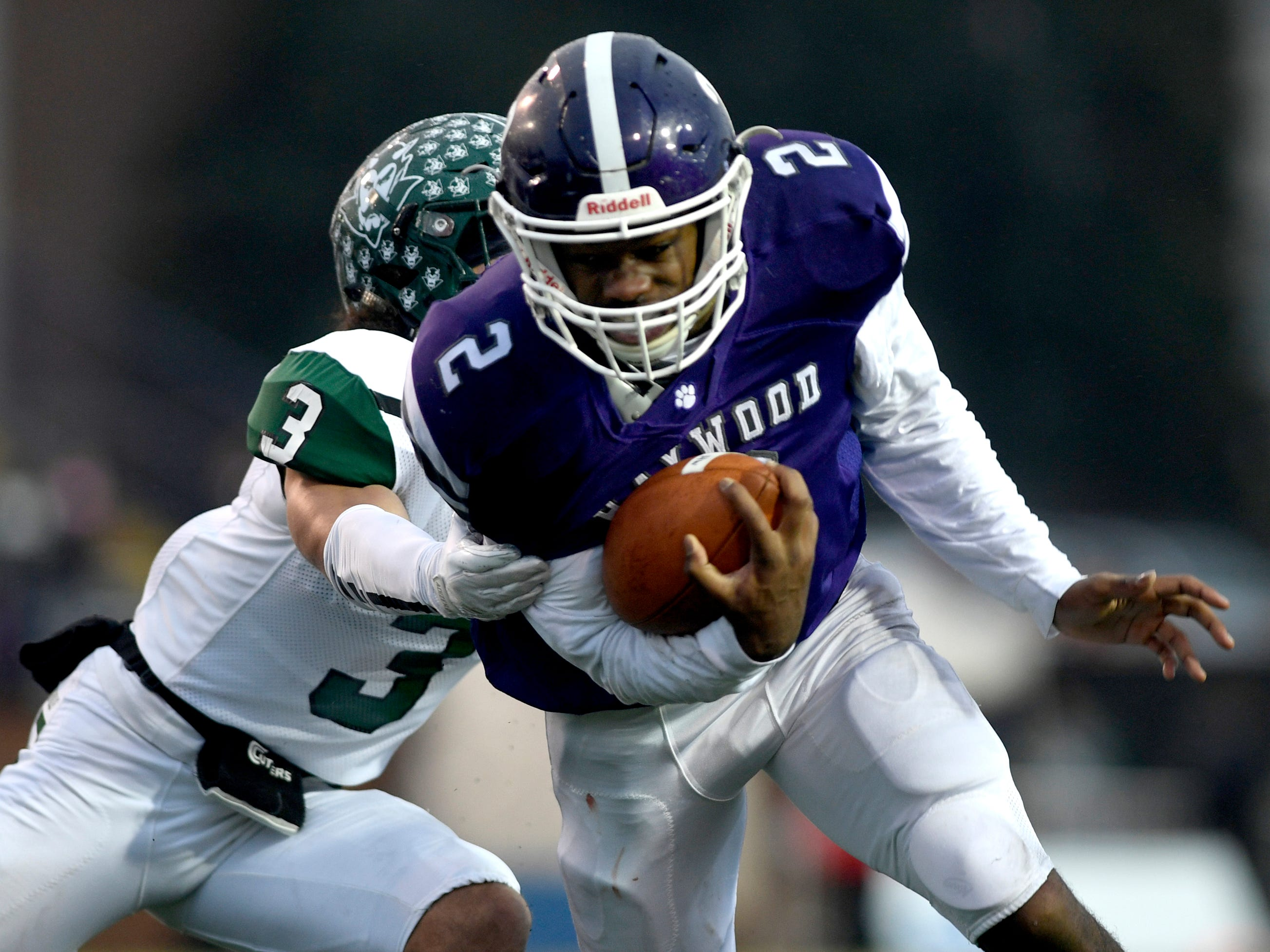 Haywood's  Deyondrius Hines (2) runs the ball as Greeneville's Jordan Gillespie (3) moves in for a tackle during the Class 4A BlueCross Bowl state championship Thursday, Nov. 29, 2018, at Tennessee Tech's Tucker Stadium in Cookeville, Tenn.