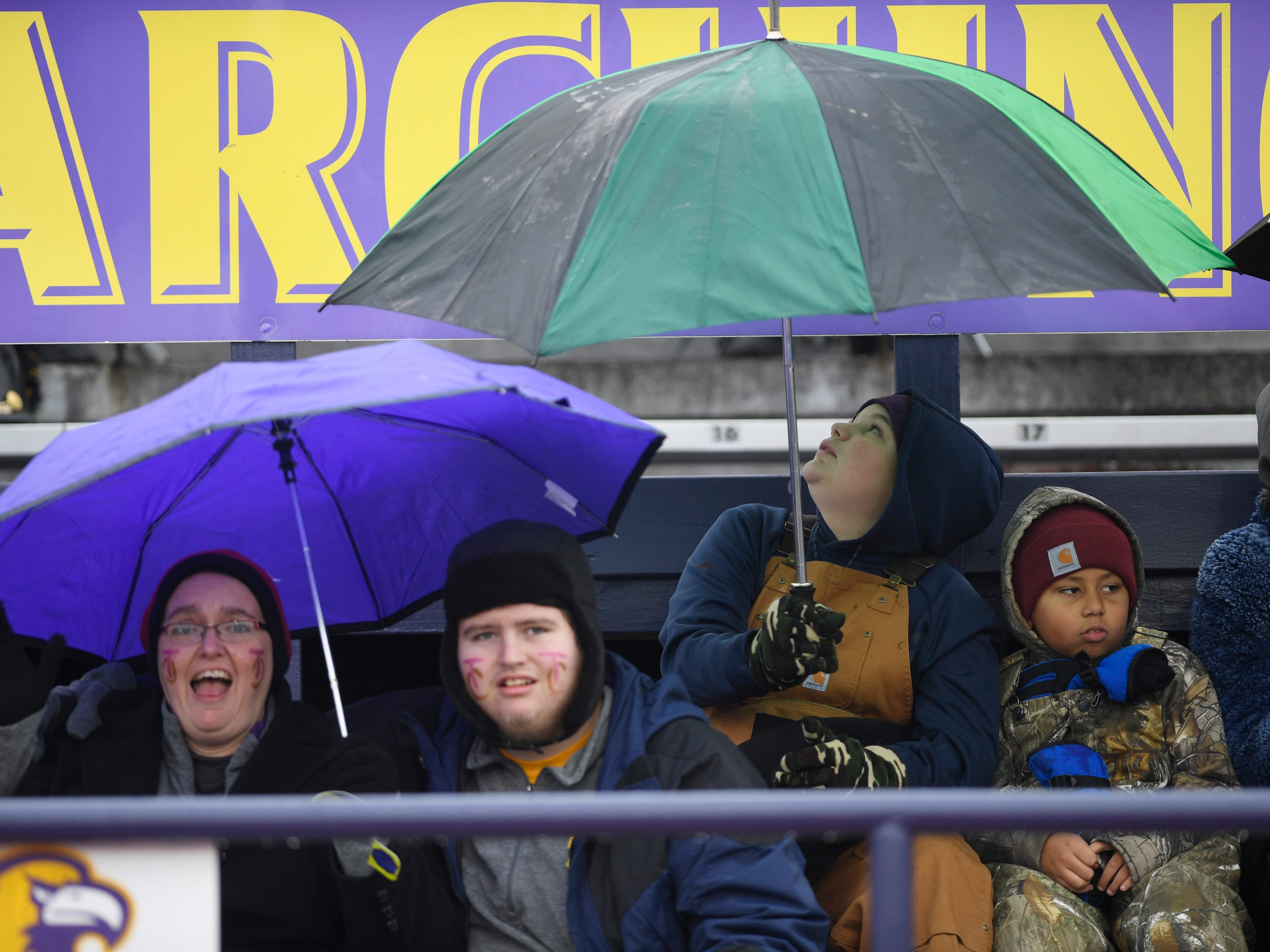 Trousdale County fans huddle against the cold and rain during the Class 2A BlueCross Bowl state championship at Tennessee Tech's Tucker Stadium in Cookeville, Tenn., on Thursday, Nov. 29, 2018.