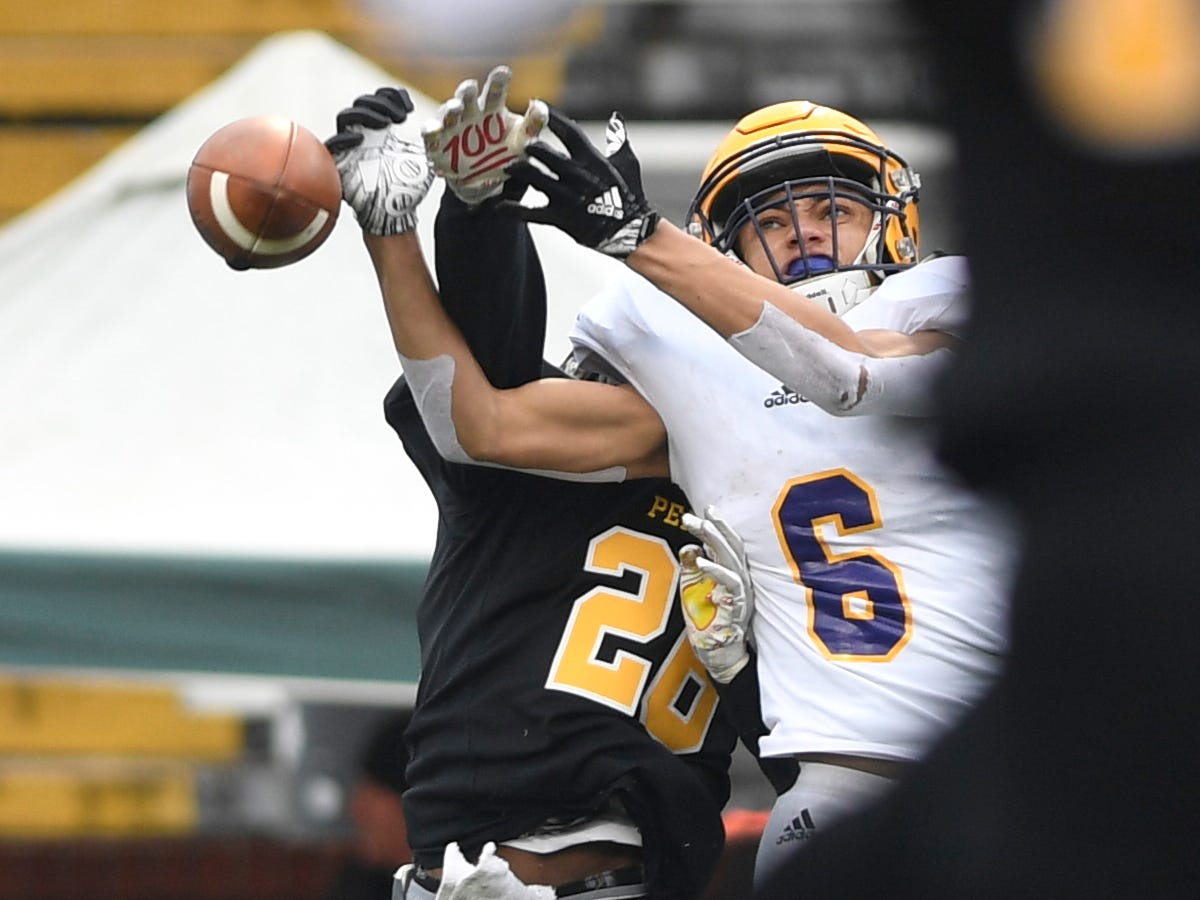 Peabody's Isaiah Jackson (26) breaks up a pass intended for Trousdale's Jayden Hicks (6) in the second quarter during the Class 2A BlueCross Bowl state championship at Tennessee Tech's Tucker Stadium in Cookeville, Tenn., on Thursday, Nov. 29, 2018.