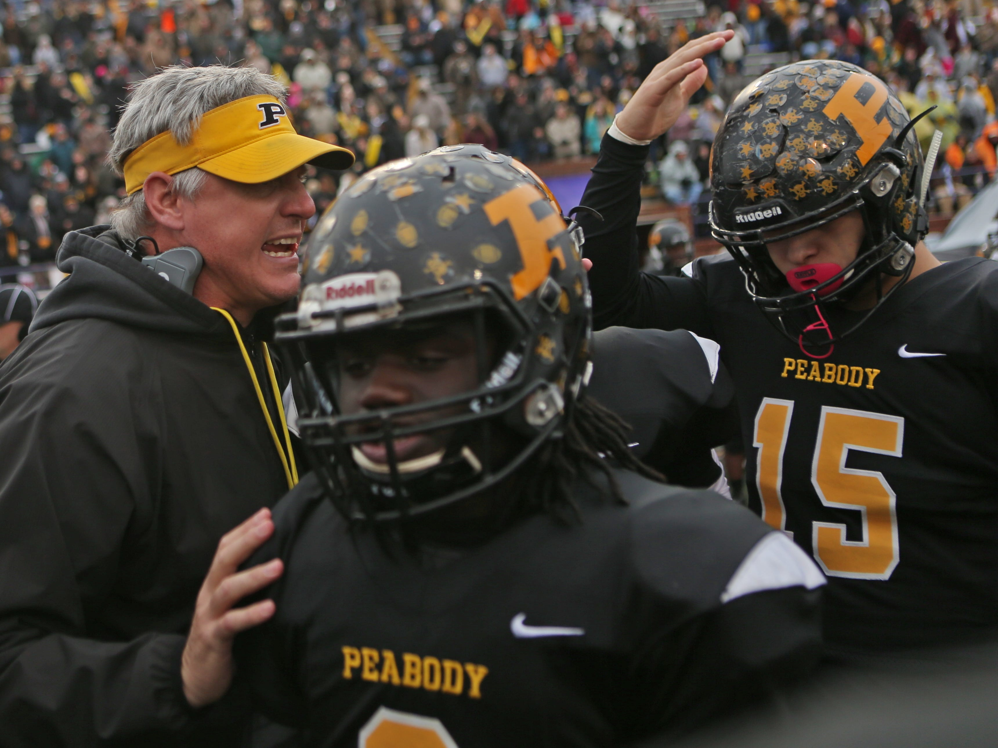 Peabody defensive coordinator Tab Vowell talks to his players at the Class 2A BlueCross Bowl state championship at Tennessee Tech's Tucker Stadium in Cookeville, Tenn., on Thursday, Nov. 29, 2018.