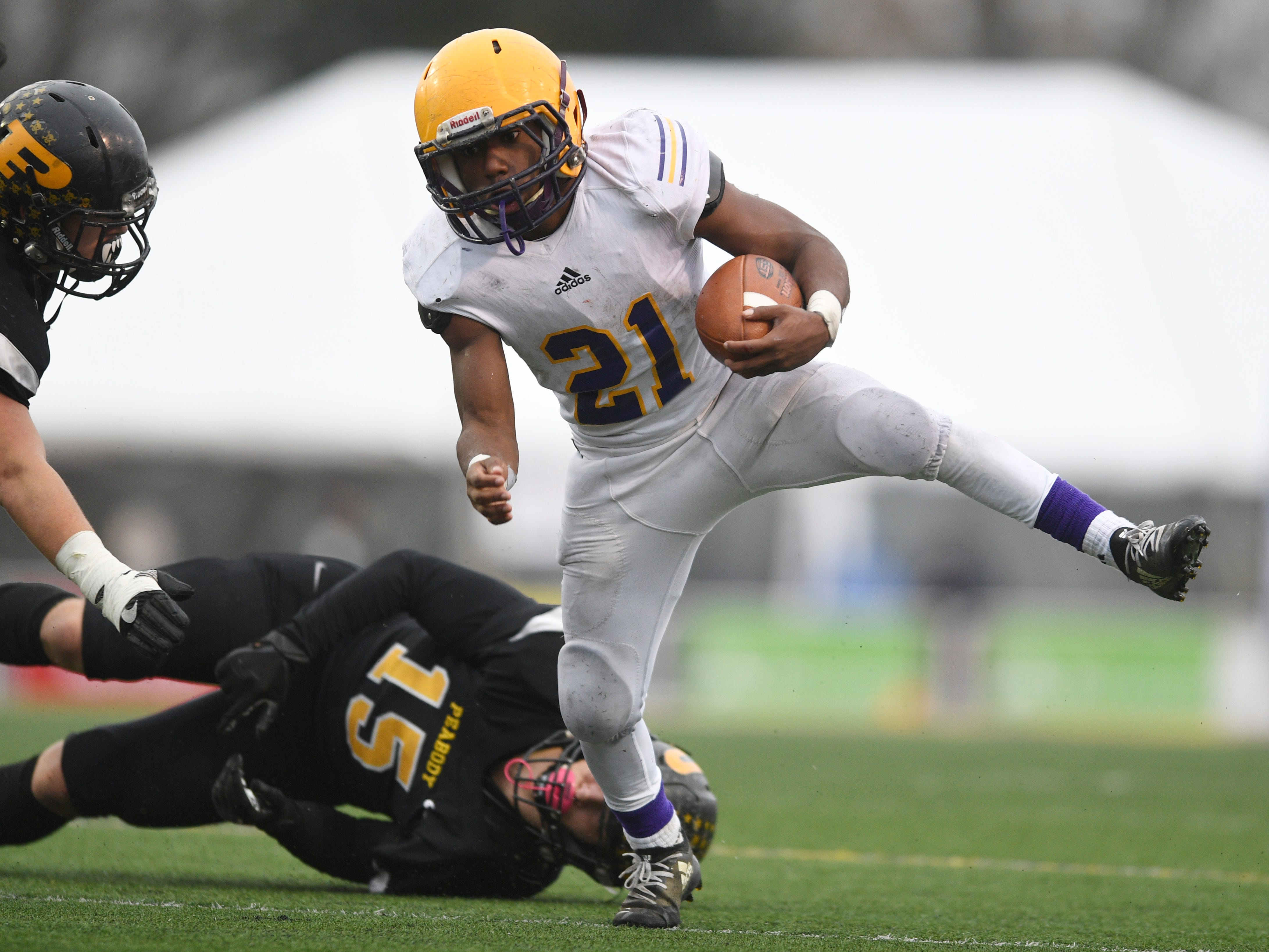 Trousdale's Dyson Satterfield (21) gains yards in the third quarter during the Class 2A BlueCross Bowl state championship at Tennessee Tech's Tucker Stadium in Cookeville, Tenn., on Thursday, Nov. 29, 2018.