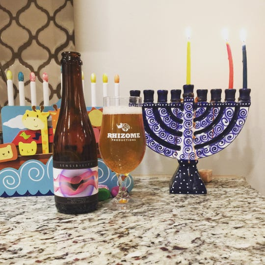 Matt Leff marks each night of Hanukkah with a different beer, taking a photo of it  with a menorah and sharing it on social media.