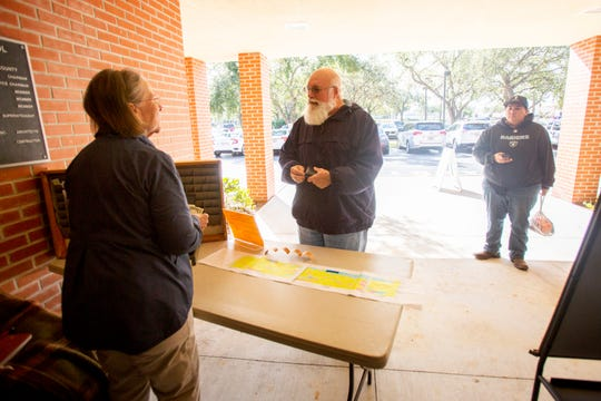 Susan Toppin, left, sells football tickets for Friday's Naples High School semifinals football game against Miami-Northwestern on Thursday, Nov. 29, 2018, at Naples High School.
