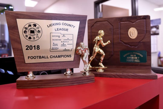 Football trophies on the desk in the front office at Johnstown-Monroe High School. The Johnnies will take on the Orrville High School Red RidersÊin the Division V state championship football game at 3 p.m. on Saturday in Canton.