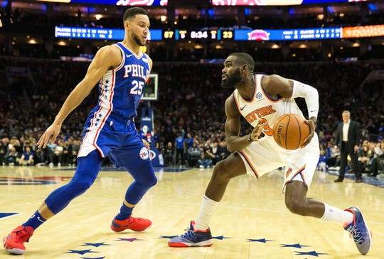 Nov 28, 2018; Philadelphia, PA, USA; New York Knicks guard Tim Hardaway Jr. (right) attempts to dribble agains Philadelphia 76ers guard Ben Simmons (25) during the second quarter at Wells Fargo Center.