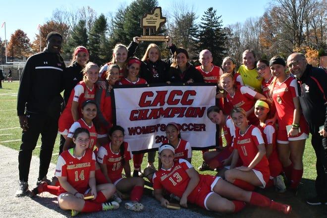 Caldwell women's soccer coach Nate Guagliardi (far right) celebrating a third CACC title with his team earlier this season.