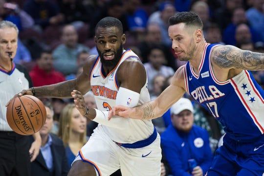 Nov 28, 2018; Philadelphia, PA, USA; New York Knicks guard Tim Hardaway Jr. (3) drives against Philadelphia 76ers guard JJ Redick (17) during the first quarter at Wells Fargo Center.