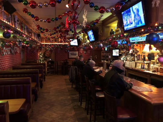 Red brick paper wall wrapping and plenty of ornaments make Grant Street Cafe seem like a homey haven during the holidays.