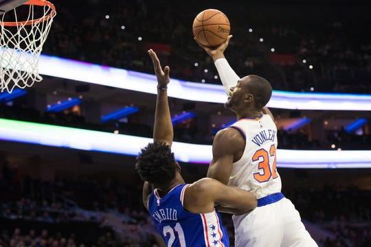 Nov 28, 2018; Philadelphia, PA, USA; New York Knicks forward Noah Vonleh (32) shoots against Philadelphia 76ers center Joel Embiid (21) during the first quarter at Wells Fargo Center.