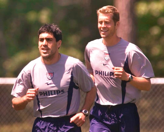 Claudio Reyna, left, and Gregg Berhalter, right, members of the U.S. Men's National Soccer Team, run a sprint drill Wednesday, May 1, 2002, in Cary, N.C.