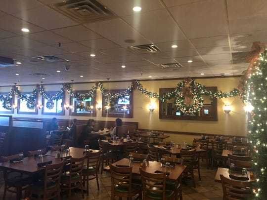 Franco's Metro Restaurant & Bar in Fort Lee incorporates massive wreathes into its holiday decor.