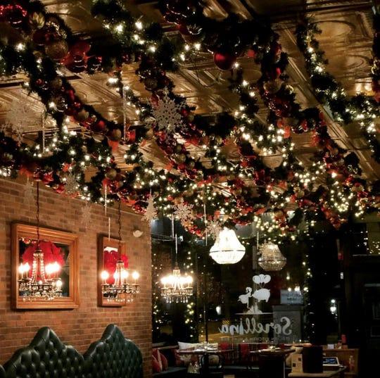 Sorellina in Hoboken has tasteful garland strung all along the gold tin ceiling.