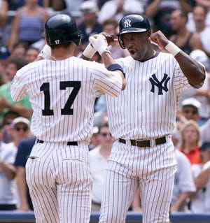 New York Yankees Chili Davis, right, celebrates with Ricky Ledee after Ledee's two-run homer in the second inning against the Montreal Expos at Yankee Stadium in New York, Sunday, July 18, 1999.  Ledee hit the first of two, two-run homers in the second inning, which put pitcher David Cone on track for a 5-0 perfect game