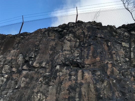 The granite wall outside the Levine reservoir is eight-feet high in some spots and must be maintained, according to the DEP.