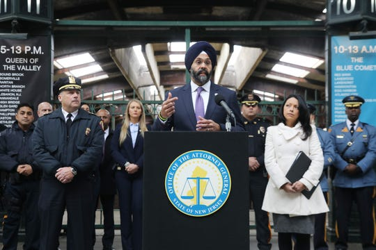 In the concourse of the Central Railroad of New Jersey Terminal at Liberty State Park in November 2018, New Jersey Attorney General Gurbir Grewal addresses the media as he announces the Immigration Trust Directive as a program to promote building trust between law enforcement and immigrant communities. He is in front of members of the New Jersey law enforcement community as they show support for his program.