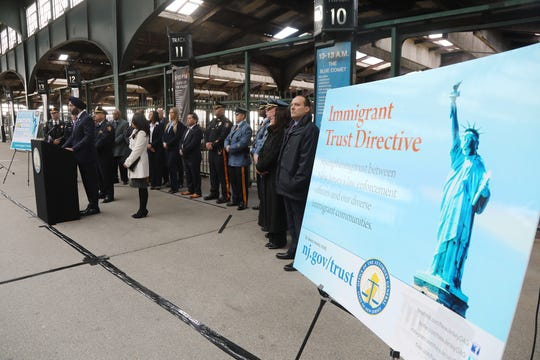 In the concourse of the Central Railroad of New Jersey Terminal at Liberty State Park, NJ Attorney General Gurbir Grewal addresses the media as he announces The Immigration Trust Directive as a program to promote building trust between law enforcement and immigrant communities. He is front of members of the New Jersey law enforcement community as they show support for his program.