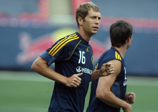Tenafly native Gregg Berhalter, far left (#16) warms up before practice with his teammates from the LA Galaxy Wednesday evening at Giants Stadium on July 15, 2009.