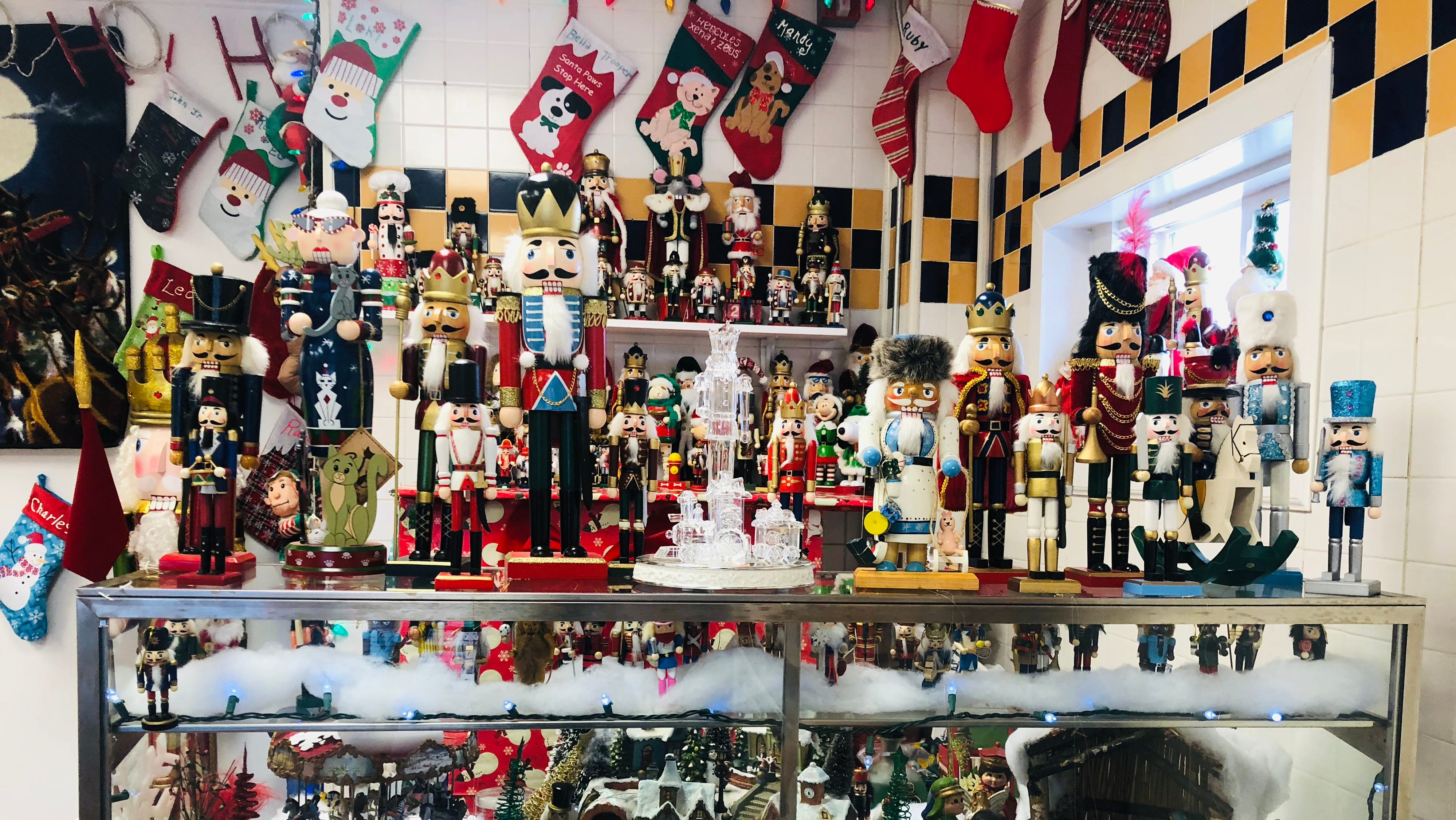 Nutcrackers line the walls, shelves and counters...