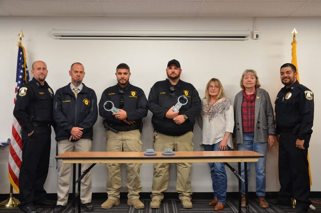 From left, Deming Police Department Chief Orosco, Captain Hogan, Code Enforcement/Animal Control Officers Rodriguez and Jasso and far right Captain Valdespino with Deming Animal Guardians ladies: From left, DAG board member Sherry McDaniel and DAG President Pat Danser.