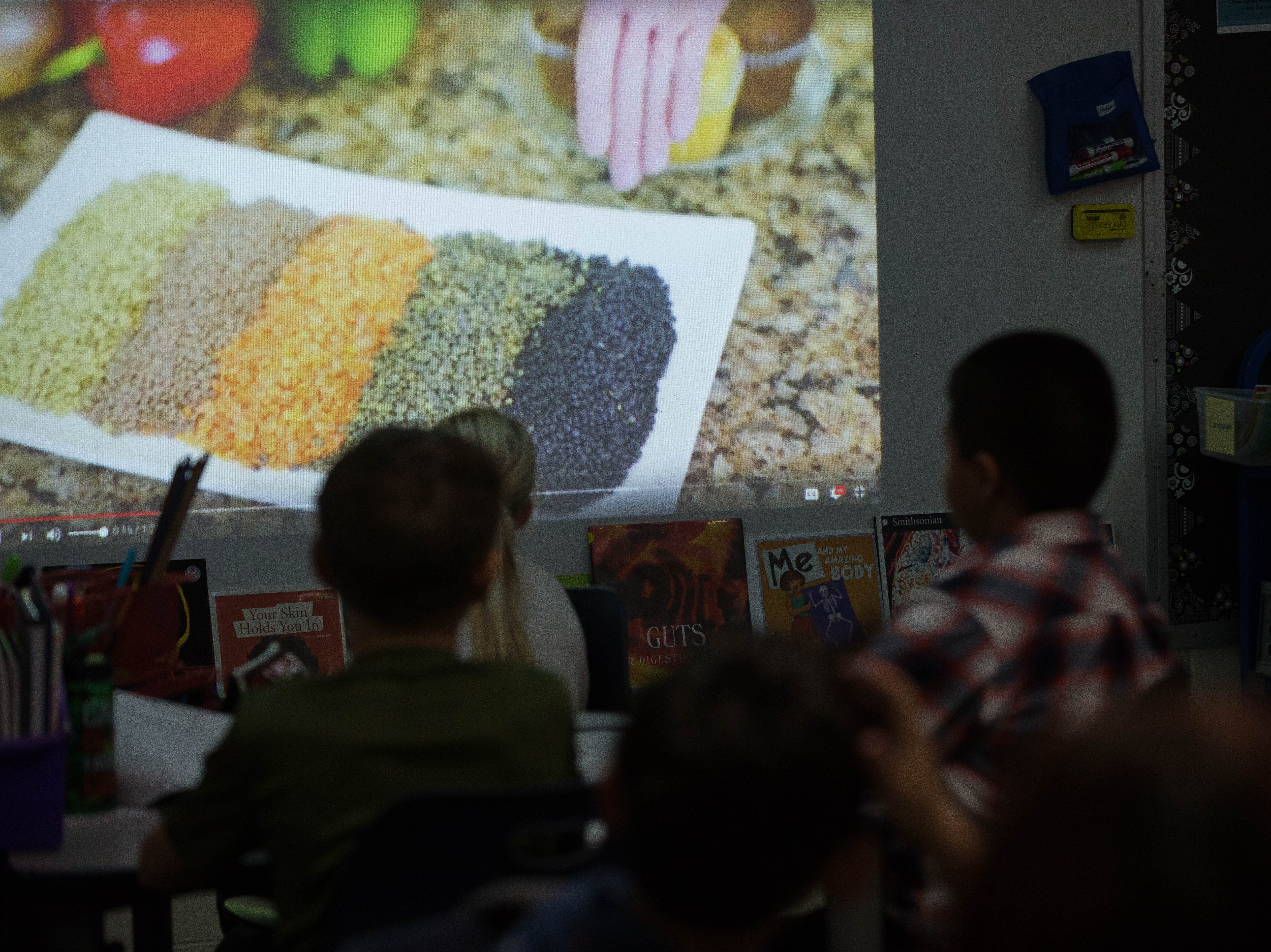 Students in Ashley Cartwright's fourth grade class watch a video about legumes on Thursday, November 29, 2018.