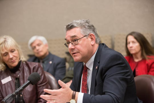 John Floros, president of New Mexico State University, right, speaks about the research implication of growing hemp in New Mexico, during a press conference, Thurday November 29, 2018.