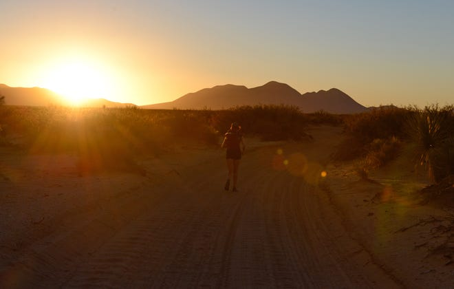 Ella Raff runs toward the Potrillo Mountains on the Monumental Loop trail. She is attempting to become the first person to run the 328-mile mountain-biking route.