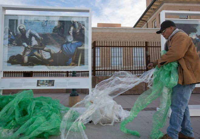 "RJ Keyonnie, with Albuqurque Tents, pulls bubble wrap apart to wrap around the replica paintings in ""The Prado in Las Cruces,"" exhibit. The traveling exhibition of paintings from the Museo National Del Prado in Madrid, Spain, was open on the Plaza de Las Cruces in September ending Thursday Nov. 29, 2018. This exhibit made three stops in New Mexico; Albuquerque, Santa Fe and here in Las Cruces."