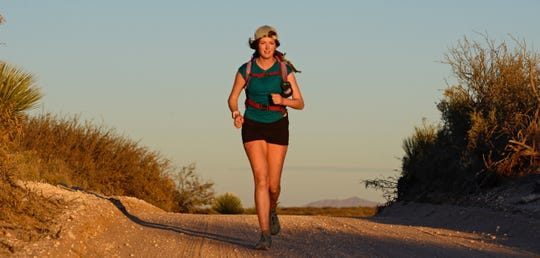 Ella Raff runs near Kilbourne Hole on the Monumental Loop trail. She is attempting to become the first person to run the 328-mile mountain-biking route.